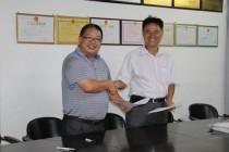 本联合社与海南省东方市钟鑫实业签订合作协议